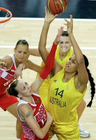 Australia's Elizabeth Cambage (14) shoots for the basket past Russia's Irina Osipova during the women's basketball bronze medal game at the 2012 Summer Olympics, Saturday, Aug. 11, 2012, in London. (AP Photo/Victor R. Caivano) Photo: Victor R. Caivano, Associated Press / AP