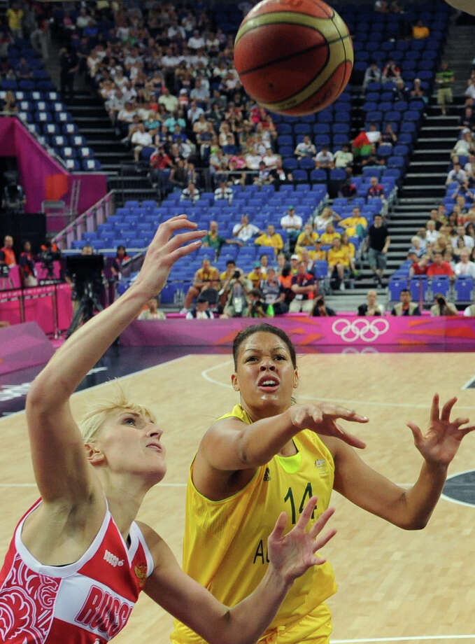Australia's Elizabeth Cambage challenges Russia's Natalya Vodopyanova for the ball during the women's basketball bronze medal game at the 2012 Summer Olympics, Saturday, Aug. 11, 2012, in London. (AP Photo/Mark Ralston, Pool) Photo: Mark Ralston, Associated Press / Pool AFP