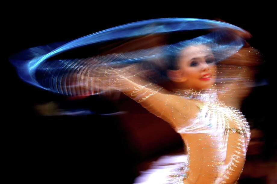 Daria Dmitrieva of Russia competes during the individual all-around rhythmic gymnastics Saturday,  (Photo by Jamie Squire/Getty Images) Photo: Jamie Squire, Ap/getty / 2012 Getty Images