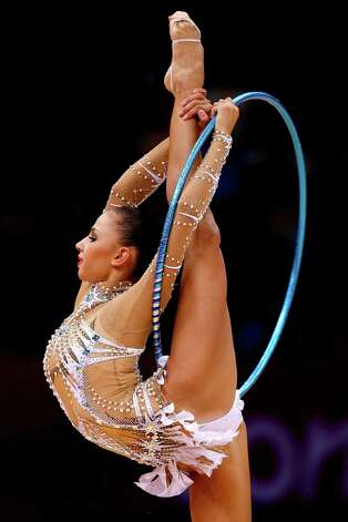 Daria Dmitrieva of Russia competes during the individual all-around rhythmic gymnastics Saturday..  (Photo by Jamie Squire/Getty Images) Photo: Jamie Squire, Ap/getty / 2012 Getty Images