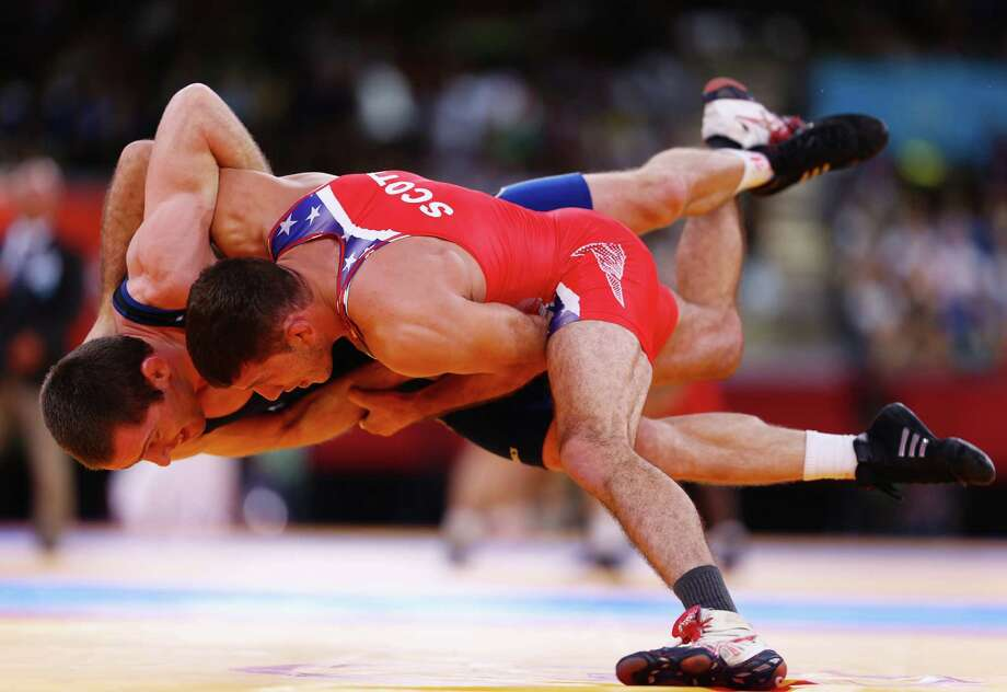 Coleman Scott of United States in action against Malkhaz Zarkua of Georgia in the men's freestyle wrestling 60kg quarterfinal match Saturday..  (Photo by Paul Gilham/Getty Images) Photo: Paul Gilham, Ap/getty / 2012 Getty Images