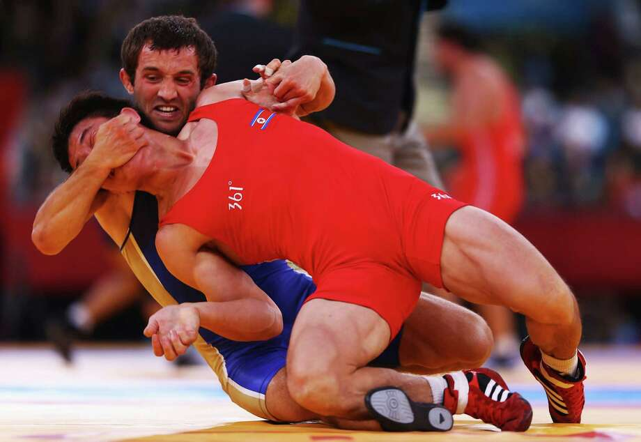 Sharif Sharifov of Azerbaijan in action against Ehsan Naser Lashgari of Iran in the men's freestyle wrestling 84kg semi-final match Saturday.  (Photo by Paul Gilham/Getty Images) Photo: Paul Gilham, Ap/getty / 2012 Getty Images
