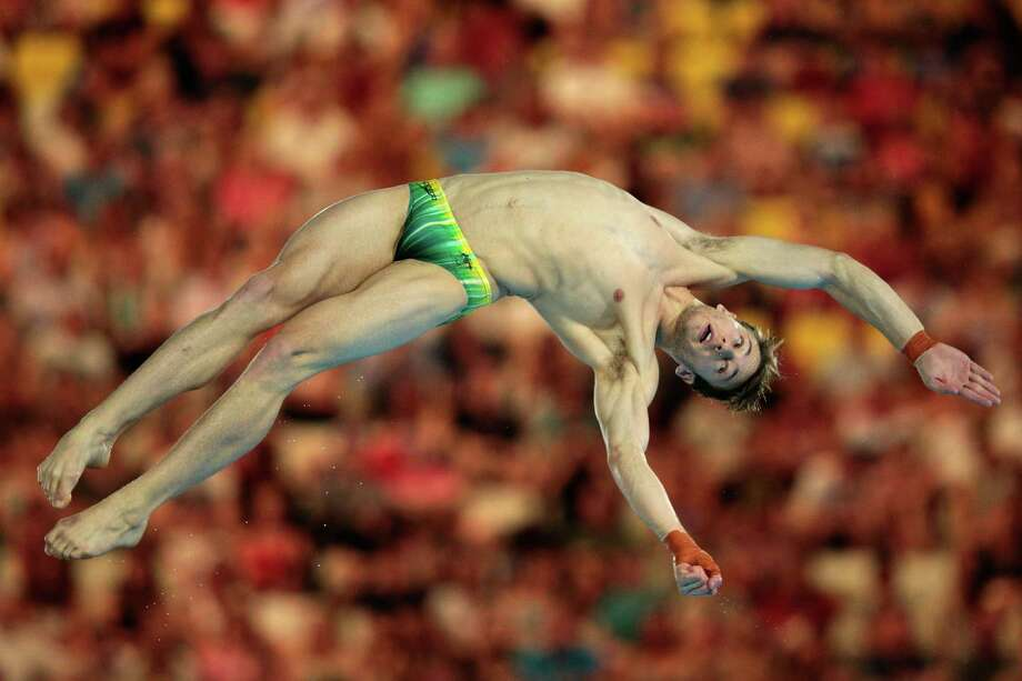 Matthew Mitcham of Australia competes in the men's 10m platform diving semifinal Saturday.  (Photo by Adam Pretty/Getty Images) Photo: Adam Pretty, Ap/getty / 2012 Getty Images