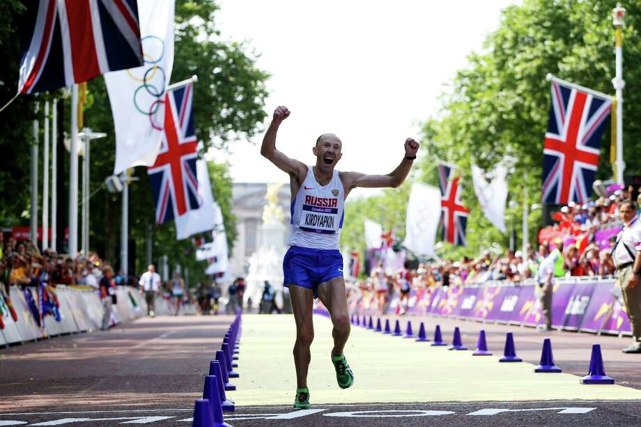 Sergey Kirdyapkin of Russia crosses the line to win gold during the men's 50km walk on Saturday.  (Photo by Streeter Lecka/Getty Images) Photo: Streeter Lecka, Ap/getty / 2012 Getty Images
