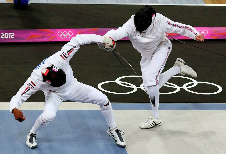 Samuel Weale (R) of Great Britain competes against Yasser Hefny (L) of Egypt in the fencing event during the men's modern pentathlon Saturday. .  (Photo by Alex Livesey/Getty Images) Photo: Alex Livesey, Ap/getty / 2012 Getty Images