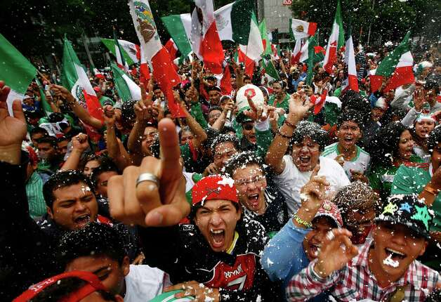 Fans of Mexico's soccer team celebrate after their team beat Brazil in the men's soccer final at the London 2012 Summer Olympics, below the Angel of Independence monument in Mexico City on Saturday. Mexico won the match 2-1 and the gold.(AP Photo/Marco Ugarte) Photo: Ap/getty