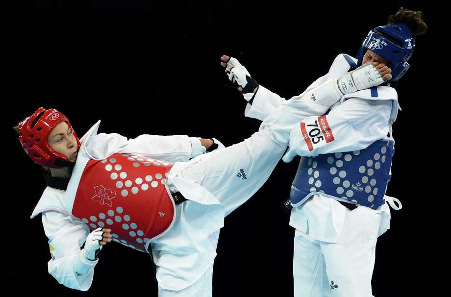 Maryna Konieva of Ukraine (red) competes against Nadin Dawani of Jordan during the women's +67kg taekwondo preliminary round on Saturday..  (Photo by Lars Baron/Getty Images) Photo: Lars Baron, Ap/getty / 2012 Getty Images