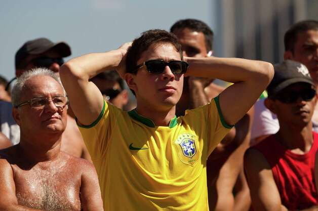 Brazil soccer fans react after Mexico scored a goal during the London 2012 Summer Olympics men's final soccer game as they watch the match on Copacabana beach in Rio de Janeiro, Brazil on Saturday. Mexico won 2-1 and the gold medal. (AP Photo/Silvia Izquierdo) Photo: Ap/getty