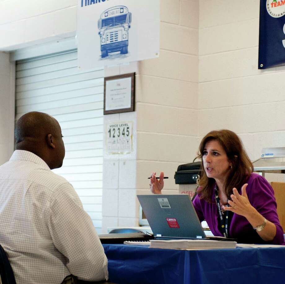 Archie Kelly, left, talks to NEISD HR Administrative Specialist Rosann Rodriguez about a potential job in the NEISD transportation department, Saturday, Aug. 11, 2012, at Castle Hills Elementary School in San Antonio. Photo: Darren Abate, For The Express-News