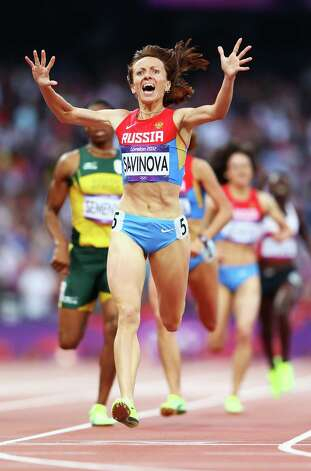 Mariya Savinova of Russia celebrates as she crosses the finish line to win gold in the women's 800m final Saturday.  (Photo by Michael Steele/Getty Images) Photo: Michael Steele, Ap/getty / 2012 Getty Images