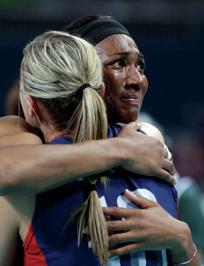 Foluke Akinradewo (16, right) cries as she hugs teammate Jordan Larson (10) after losing to Brazil 3-1 during the gold medal volleyball match. (AP Photo/Chris O'Meara) Photo: Ap/getty