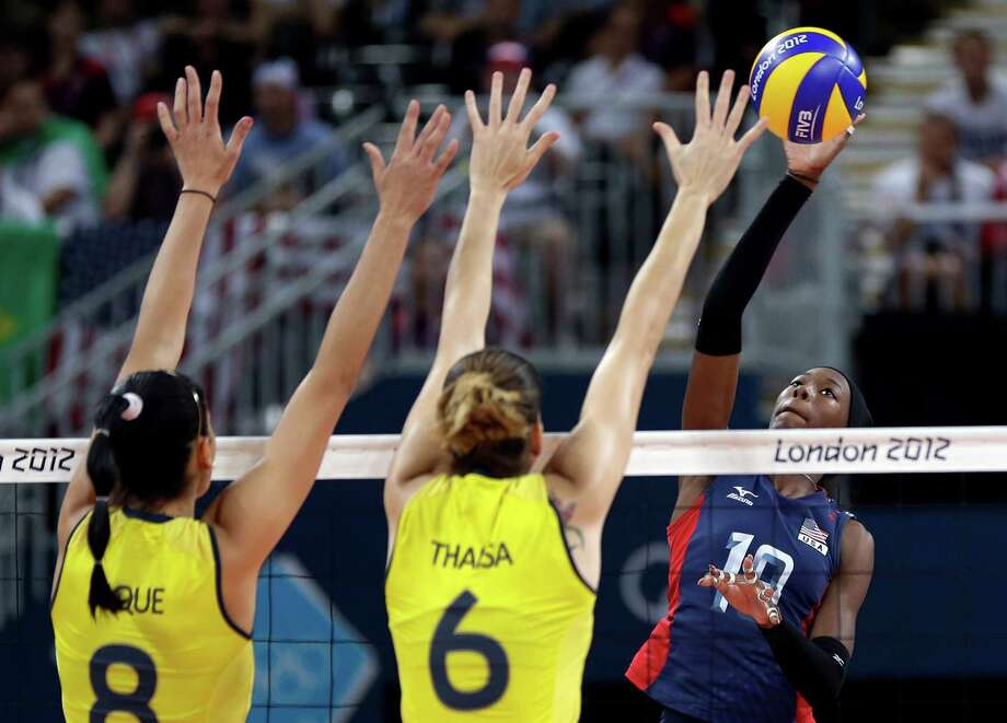 USA's Destinee Hooker (19, right) prepares to smash the ball past Brazil's Jaqueline Carvalho (8) and Thaisa Menezes (6) during a women's volleyball gold medal match at the 2012 Summer Olympics Saturday, Aug. 11, 2012, in London. (AP Photo/Chris O'Meara) Photo: Chris O'Meara / AP