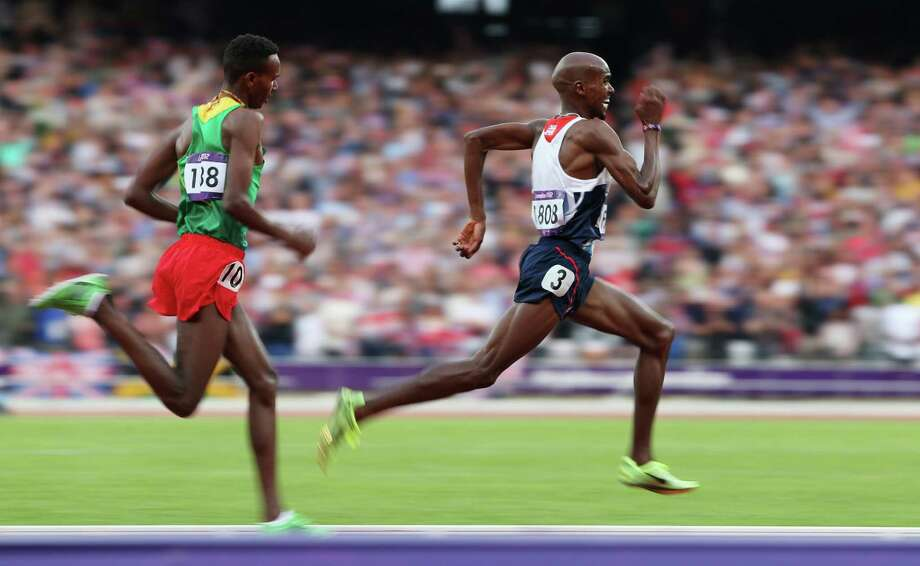 Mohamed Farah of Great Britain approaches the finish line on his way to winning gold ahead of Dejen Gebremeskel of Ethiopia as they compete in the men's 5000m final Saturday. (Photo by Clive Brunskill/Getty Images) Photo: Clive Brunskill, Ap/getty / 2012 Getty Images