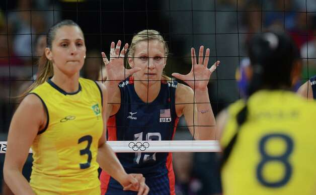 US Christa Harmotto (C) gestures during the women's volleyball gold medal match of the London 2012 Olympics Games against Brazil, in London on August 11, 2012.   AFP PHOTO / KIRILL KUDRYAVTSEVKIRILL KUDRYAVTSEV/AFP/GettyImages Photo: KIRILL KUDRYAVTSEV, AFP/Getty Images / AFP
