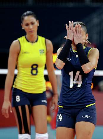 Brazil's Fabiana Oliveira (14) and Jaqueline Carvalho (8) react as the USA scores a point during a women's volleyball gold medal match at the 2012 Summer Olympics Saturday, Aug. 11, 2012, in London. (AP Photo/Chris O'Meara) Photo: Chris O'Meara, Associated Press / AP