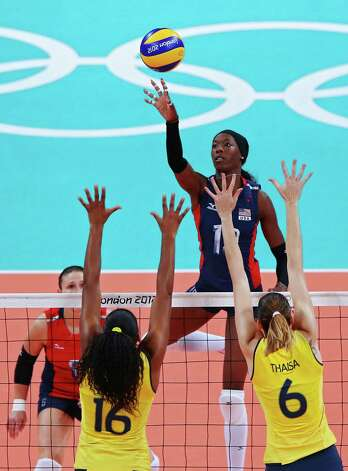 LONDON, ENGLAND - AUGUST 11:  Destinee Hooker #19 of United States attempts to hit the ball over Fernanda Rodrigues #16 and Thaisa Menezes #6 of Brazil during the Women's Volleyball gold medal match on Day 15 of the London 2012 Olympic Games at Earls Court on August 10, 2012 in London, England. Photo: Ezra Shaw, Getty Images / 2012 Getty Images