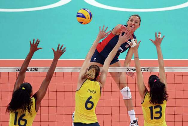 LONDON, ENGLAND - AUGUST 11:  Jordan Larson #10 of United States goes up for the spike against Fernanda Rodrigues #16, Thaisa Menezes #6 and Sheilla Castro #13 of Brazil during the Women's Volleyball gold medal match on Day 15 of the London 2012 Olympic Games at Earls Court on August 10, 2012 in London, England. Photo: Ezra Shaw, Getty Images / 2012 Getty Images