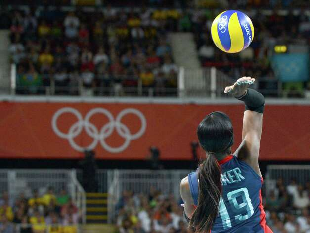 US Destinee Hooker hits the ball during the women's volleyball gold medal match of the London 2012 Olympics Games against Brazil, in London on August 11, 2012.    AFP PHOTO / KIRILL KUDRYAVTSEVKIRILL KUDRYAVTSEV/AFP/GettyImages Photo: KIRILL KUDRYAVTSEV, AFP/Getty Images / AFP