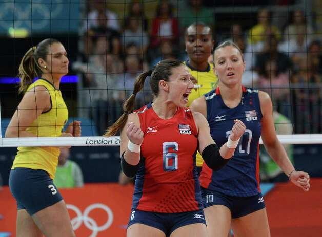US Nicole Davis (C) and Jordan Larson (R) celebrate during the women's volleyball gold medal match of the London 2012 Olympics Games against Brazil, in London on August 11, 2012.    AFP PHOTO / KIRILL KUDRYAVTSEVKIRILL KUDRYAVTSEV/AFP/GettyImages Photo: KIRILL KUDRYAVTSEV, AFP/Getty Images / AFP