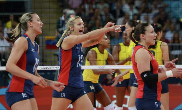 (L-R) US Jordan Larson, Christa Harmotto and Nicole Davis celebrate during the women's volleyball gold medal match of the London 2012 Olympics Games against Brazil, in London on August 11, 2012.    AFP PHOTO / KIRILL KUDRYAVTSEVKIRILL KUDRYAVTSEV/AFP/GettyImages Photo: KIRILL KUDRYAVTSEV, AFP/Getty Images / AFP