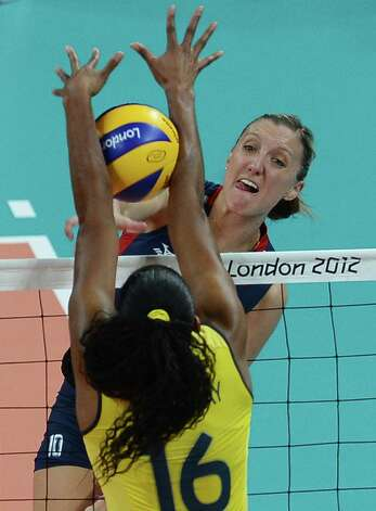 Brazil's Fernanda Rodrigues blocks US Jordan Larson (top) during the women's volleyball gold medal match of the London 2012 Olympics Games, in London on August 11, 2012.  AFP PHOTO / FRANCISCO LEONGFRANCISCO LEONG/AFP/GettyImages Photo: FRANCISCO LEONG, AFP/Getty Images / AFP
