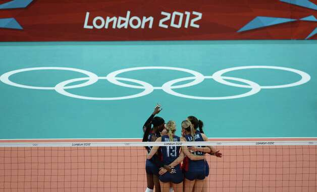 The US team celebrates during the women's volleyball gold medal match of the London 2012 Olympics Games against Brazil, in London on August 11, 2012.  AFP PHOTO / FRANCISCO LEONGFRANCISCO LEONG/AFP/GettyImages Photo: FRANCISCO LEONG, AFP/Getty Images / AFP