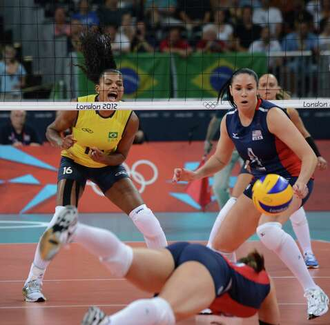 Brazil's Fernanda Rodrigues (L) and US Lindsey Berg (R) look at US Nicole Davis during the women's volleyball gold medal match of the London 2012 Olympics Games, in London on August 11, 2012.  AFP PHOTO / FRANCISCO LEONGKIRILL KUDRYAVTSEV/AFP/GettyImages Photo: KIRILL KUDRYAVTSEV, AFP/Getty Images / AFP