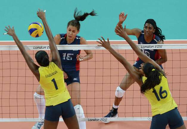 Brazil's Fabiana Claudino (L) and Fernanda Rodrigues block US Foluke Akinradewo (2-L) and Destinee Hooker during the women's volleyball gold medal match of the London 2012 Olympics Games, in London on August 11, 2012.  AFP PHOTO / FRANCISCO LEONGFRANCISCO LEONG/AFP/GettyImages Photo: FRANCISCO LEONG, AFP/Getty Images / AFP