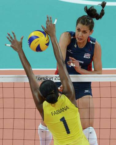 Brazil's Fabiana Claudino blocks US Foluke Akinradewo (top) during the women's volleyball gold medal match of the London 2012 Olympics Games, in London on August 11, 2012.  AFP PHOTO / FRANCISCO LEONGFRANCISCO LEONG/AFP/GettyImages Photo: FRANCISCO LEONG, AFP/Getty Images / AFP
