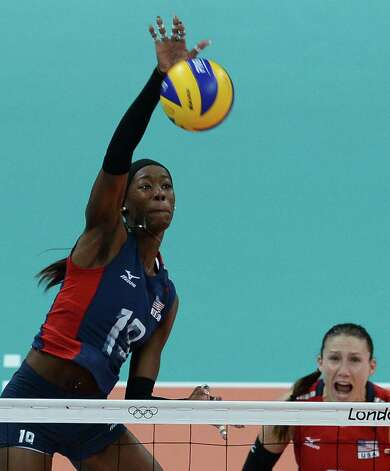Team USA's Destinee Hooker, from San Antonio, spikes the ball during Saturday's match against Brazil. Hooker was limited to a tournament-low 14 points. Photo: FRANCISCO LEONG, AFP/Getty Images / AFP