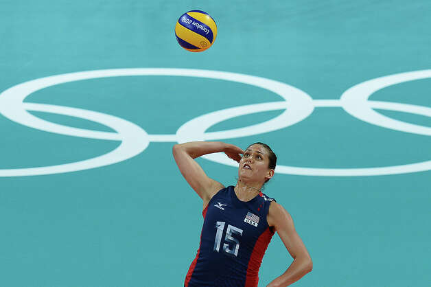 US Logan Tom serves during the women's volleyball gold medal match of the London 2012 Olympics Games against Brazil, in London on August 11, 2012.  AFP PHOTO / FRANCISCO LEONGFRANCISCO LEONG/AFP/GettyImages Photo: FRANCISCO LEONG, AFP/Getty Images / AFP