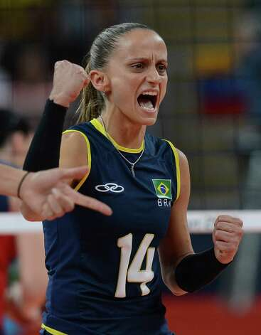 Brazil's Fabiana Oliveira celebrates during the women's volleyball gold medal match of the London 2012 Olympics Games against the US, in London on August 11, 2012.   AFP PHOTO / KIRILL KUDRYAVTSEVKIRILL KUDRYAVTSEV/AFP/GettyImages Photo: KIRILL KUDRYAVTSEV, AFP/Getty Images / AFP