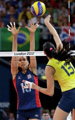 USA's Logan Tom (15) goes up for a block on a spike by Brazil's Sheilla Castro (13) during a women's volleyball gold medal match at the 2012 Summer Olympics Saturday, Aug. 11, 2012, in London. (AP Photo/Chris O'Meara) Photo: Chris O'Meara, Associated Press / AP