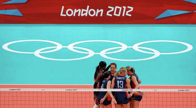 LONDON, ENGLAND - AUGUST 11:  The United States huddles up against Brazil during the Women's Volleyball gold medal match on Day 15 of the London 2012 Olympic Games at Earls Court on August 10, 2012 in London, England. Photo: Ezra Shaw, Getty Images / 2012 Getty Images