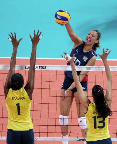 LONDON, ENGLAND - AUGUST 11:  Jordan Larson #10 of United States goes up for the spike against Fabiana Claudino #1 and Sheilla Castro #13 of Brazil during the Women's Volleyball gold medal match on Day 15 of the London 2012 Olympic Games at Earls Court on August 10, 2012 in London, England. Photo: Ezra Shaw, Getty Images / 2012 Getty Images