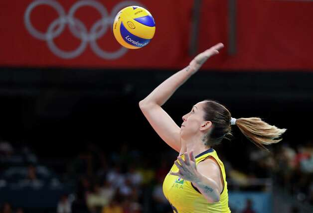 LONDON, ENGLAND - AUGUST 11:  Thaisa Menezes #6 of Brazil serves against United States during the Women's Volleyball gold medal match on Day 15 of the London 2012 Olympic Games at Earls Court on August 10, 2012 in London, England. Photo: Elsa, Getty Images / 2012 Getty Images