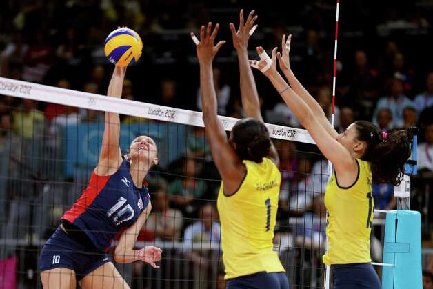 LONDON, ENGLAND - AUGUST 11:  Jordan Larson #10 of United States goes up for the spike against Fabiana Claudino #1 and Sheilla Castro #13 of Brazil during the Women's Volleyball gold medal match on Day 15 of the London 2012 Olympic Games at Earls Court on August 10, 2012 in London, England. Photo: Elsa, Getty Images / 2012 Getty Images