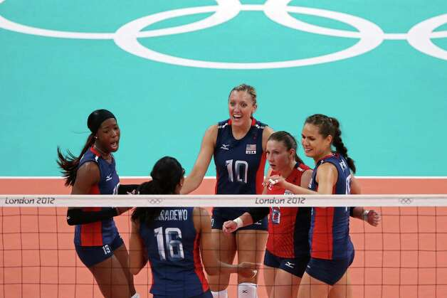 LONDON, ENGLAND - AUGUST 11:  Destinee Hooker #19, Foluke Akinradewo #16, Jordan Larson #10, Nicole Davis #6 and Logan Tom #15 of United States celebrates after a point against Brazil during the Women's Volleyball gold medal match on Day 15 of the London 2012 Olympic Games at Earls Court on August 10, 2012 in London, England. Photo: Ezra Shaw, Getty Images / 2012 Getty Images