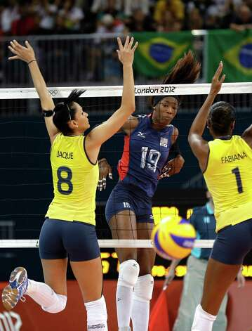 USA's Destinee Hooker (19) watches her spike get past Brazil's Jaqueline Carvalho (8) and Fabiana Claudino (1) during a women's volleyball gold medal match at the 2012 Summer Olympics Saturday, Aug. 11, 2012, in London. (AP Photo/Chris O'Meara) Photo: Chris O'Meara, Associated Press / AP