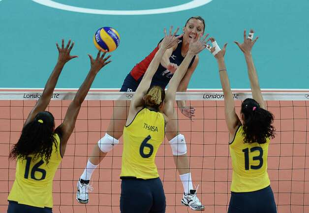 (L-R) Brazil's Fernanda Rodrigues, Thaisa Menezes and Sheilla Castro block US Jordan Larson during the women's volleyball gold medal match of the London 2012 Olympics Games against the US, in London on August 11, 2012.  AFP PHOTO / FRANCISCO LEONGFRANCISCO LEONG/AFP/GettyImages Photo: FRANCISCO LEONG, AFP/Getty Images / AFP