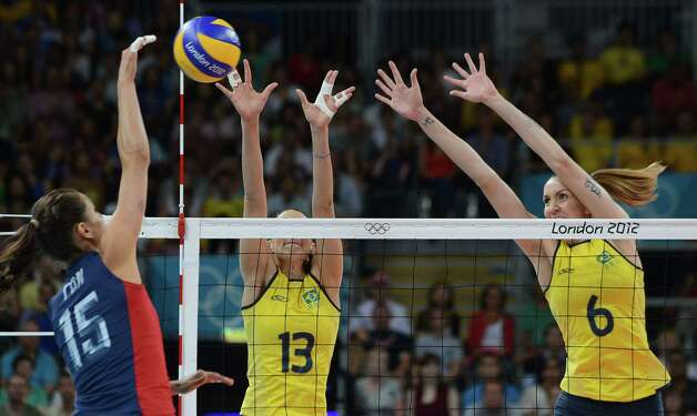 Brazil's Sheilla Castro (C) and Thaisa Menezes block US Logan Tom (L) during the women's volleyball gold medal match of the London 2012 Olympics Games, in London on August 11, 2012.   AFP PHOTO / KIRILL KUDRYAVTSEVKIRILL KUDRYAVTSEV/AFP/GettyImages Photo: KIRILL KUDRYAVTSEV, AFP/Getty Images / AFP
