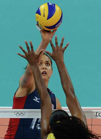 Brazil's Fernanda Rodrigues (R) blocks US Logan Tom during the women's volleyball gold medal match of the London 2012 Olympics Games, in London on August 11, 2012.    AFP PHOTO / FRANCISCO LEONGFRANCISCO LEONG/AFP/GettyImages Photo: FRANCISCO LEONG, AFP/Getty Images / AFP