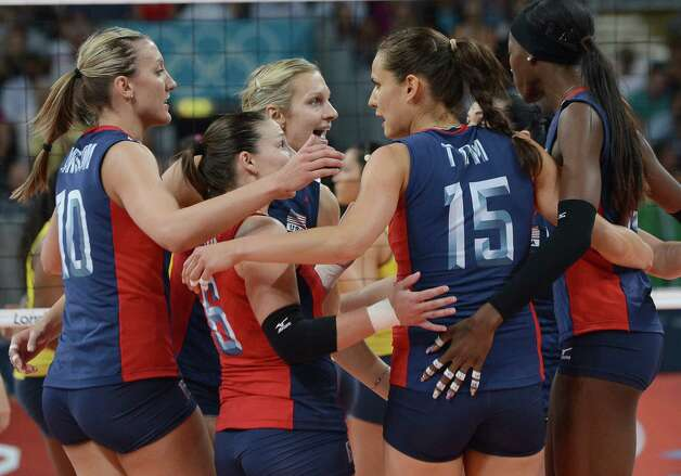 The US team celebrates during the women's volleyball gold medal match of the London 2012 Olympics Games against Brazil, in London on August 11, 2012.    AFP PHOTO / KIRILL KUDRYAVTSEVKIRILL KUDRYAVTSEV/AFP/GettyImages Photo: KIRILL KUDRYAVTSEV, AFP/Getty Images / AFP