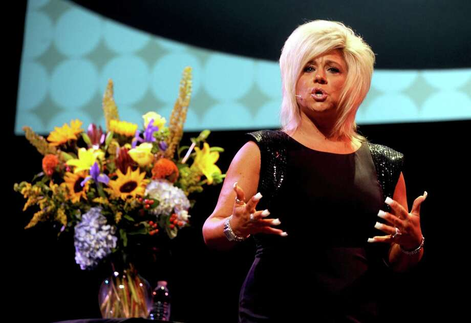"Theresa Caputo talks on stage at the Palace Theater in Stamford on Saturday, August 11, 2012. Caputo is the star of the television show, ""Long Island Medium."" Photo: Lindsay Niegelberg / Stamford Advocate"