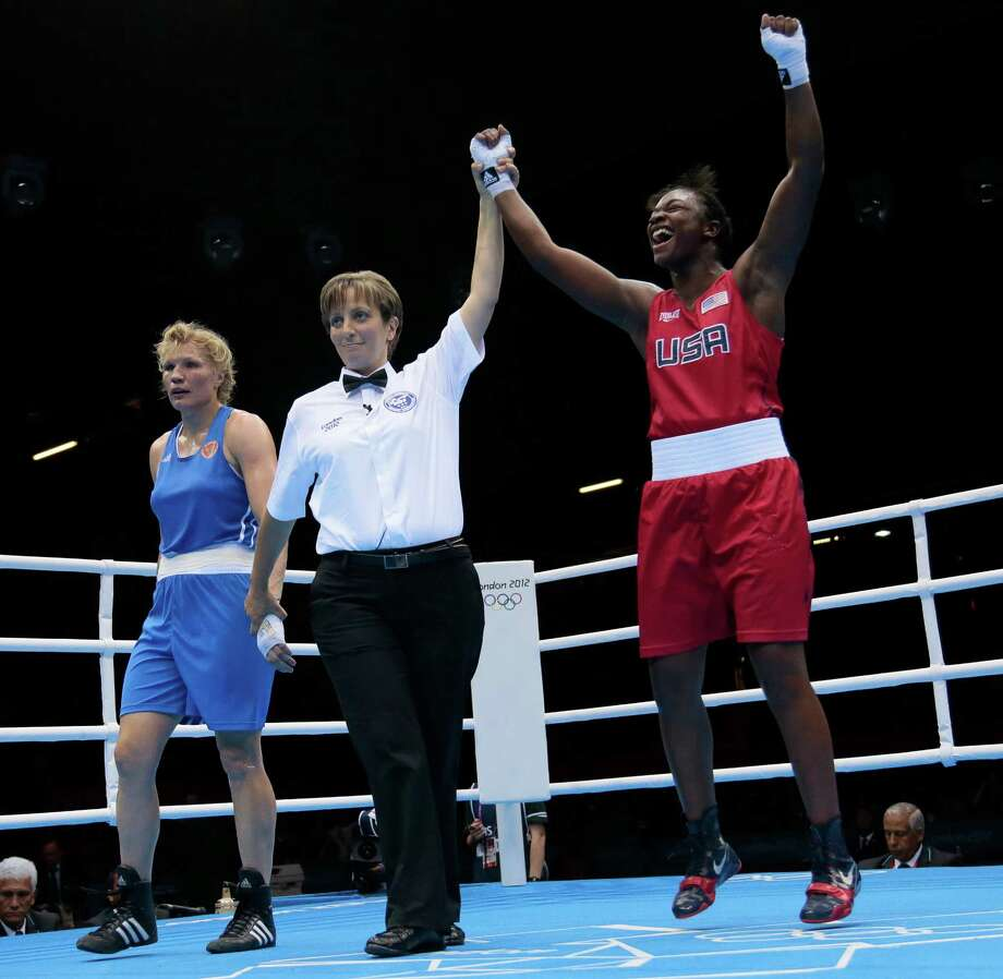 Claressa Shields (right) celebrates winning gold against Russia's Nadezda Torlopova in the women's middleweight division. The American men failed to medal for the first time. Photo: Ivan Sekretarev, Associated Press / AP