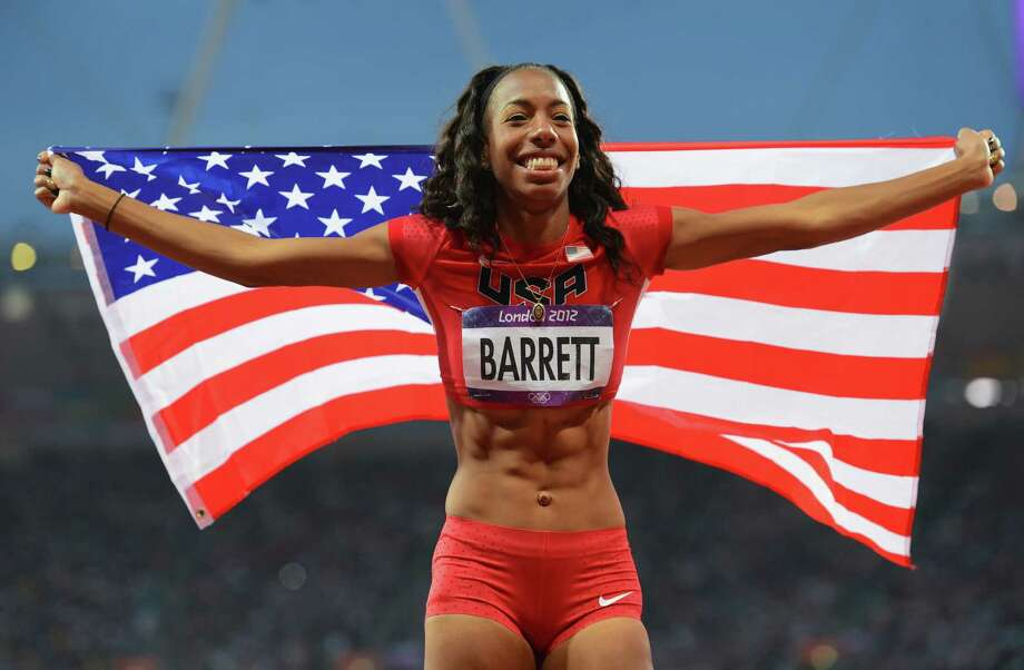 Brigetta Barrett of the United States celebrates wining silver in the high jump on Saturday. Photo: Mike Hewitt, Getty / 2012 Getty Images