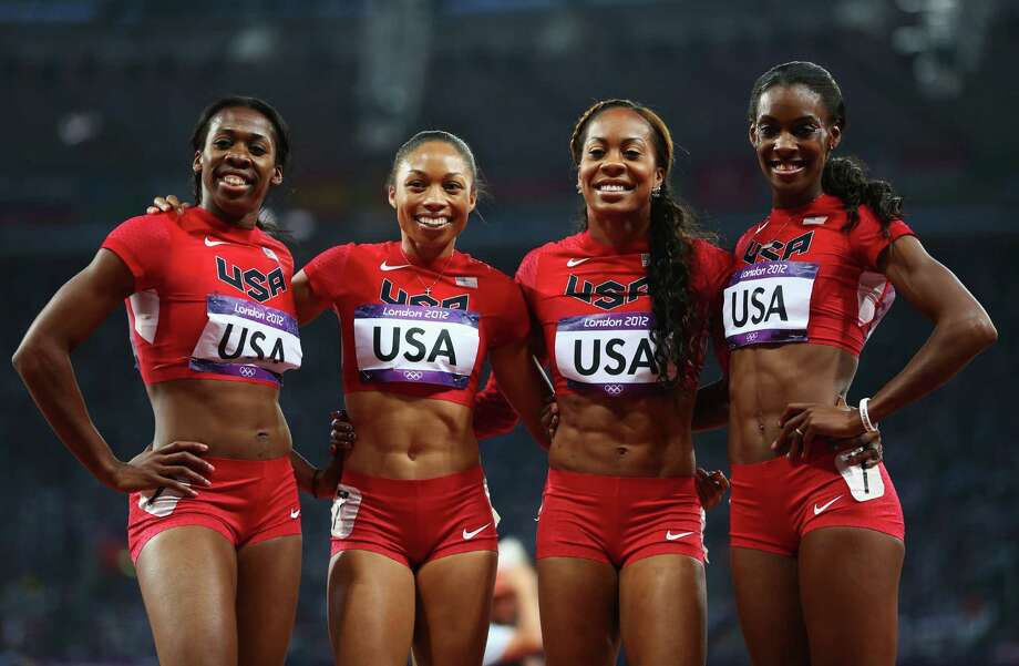 Francena McCorory, Allyson Felix, Sanya Richards-Ross and DeeDee Trotter of the United States celebrate winning gold in the women's 4 x 400m relay Saturday. Photo: Michael Steele, Getty / 2012 Getty Images