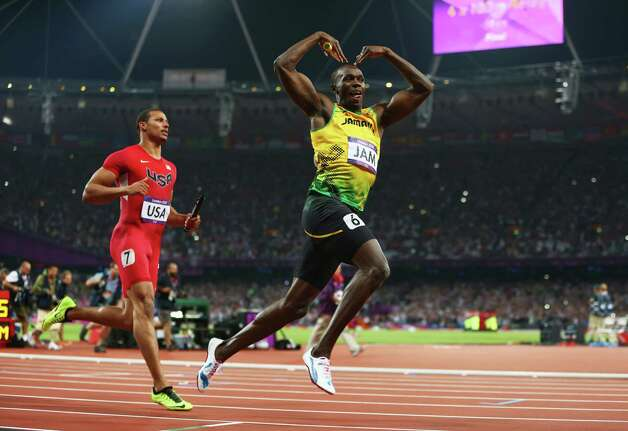 Usain Bolt of Jamaica celebrates crossing the finish line ahead of Ryan Bailey of the United States to win gold and set a world record of 36.84 during the men's 4 x 100m  relay Saturday. Photo: Michael Steele, Getty / 2012 Getty Images