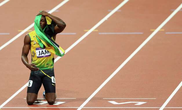Usain Bolt of Jamaica celebrates winning gold and setting a new world record of 36.84 during the men's 4 x 100m relay Saturday. Photo: Streeter Lecka, Getty / 2012 Getty Images