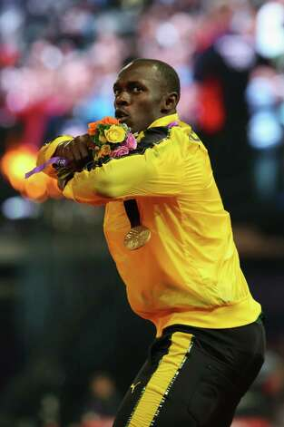 Usain Bolt of Jamaica poses on the podium during the medal ceremony for the men's 4 x 100m relay. Jamaica won in world-record time.. Photo: Ronald Martinez, Getty / 2012 Getty Images